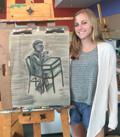 Elle with her finished sketch.