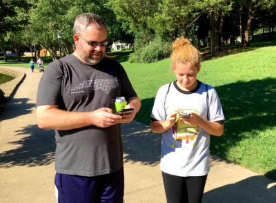 Father and daughter play the game in the park